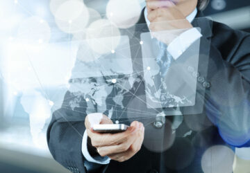 Double exposure of businessman shows modern technology as concept