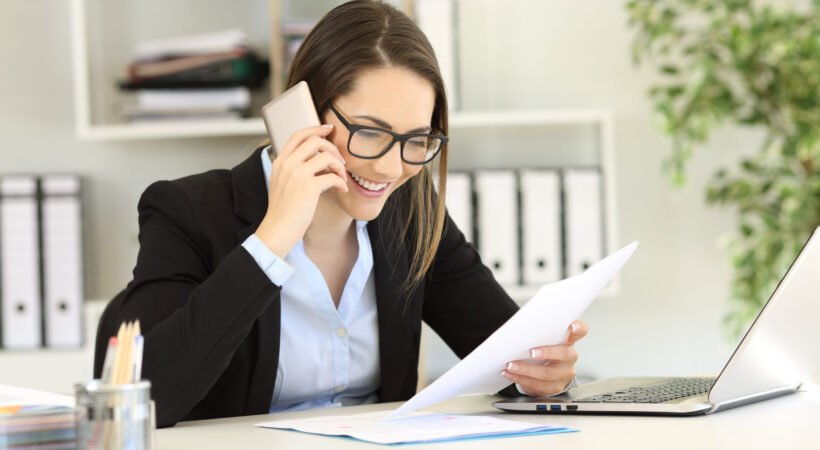 Happy customer calling support service about a paper document at office