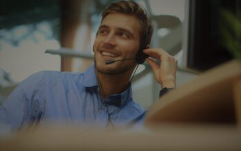 Smiling friendly handsome young male call centre operator